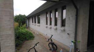 Vandskuring af facade ved Murerfirmaet Romvig